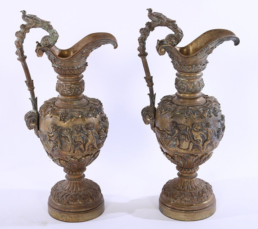 PAIR 19TH CENT. BRONZE EWERS RAMS HEADS