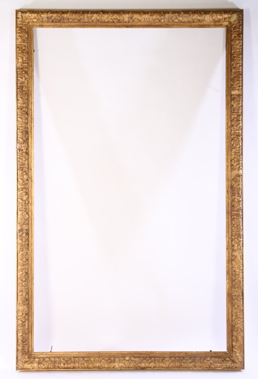 LARGE GILTWOOD CARVED GESSO DECORATED FRAME