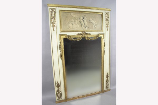 CARVED AND GILTWOOD TRUMEAU MIRROR PAINTED CHERUBS