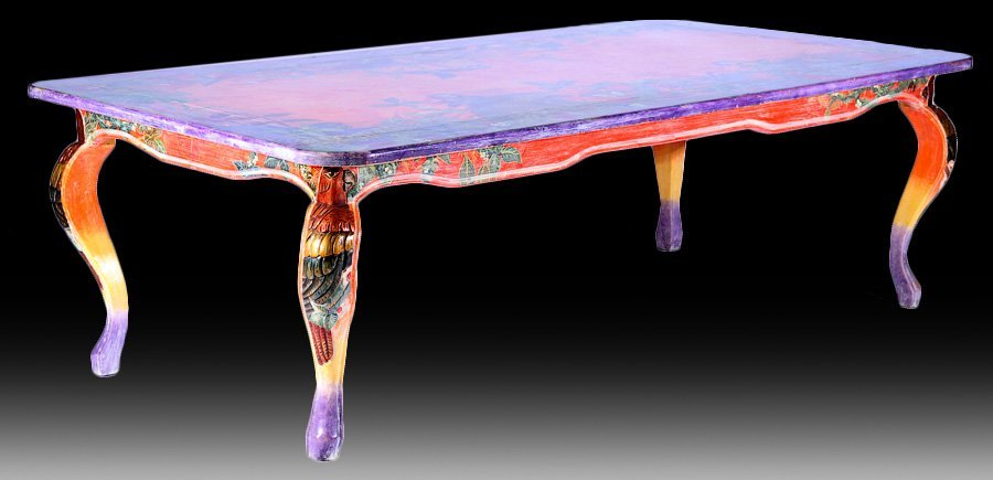 A PAINTED DINING TABLE ON CARVED LEGS