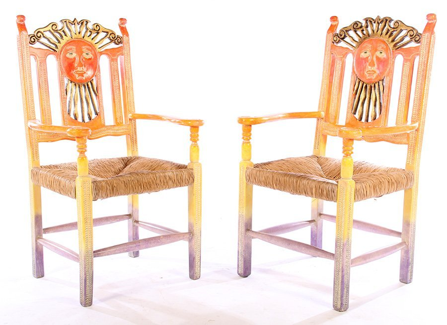 A PAIR OF CARVED AND PAINTED ARM CHAIRS