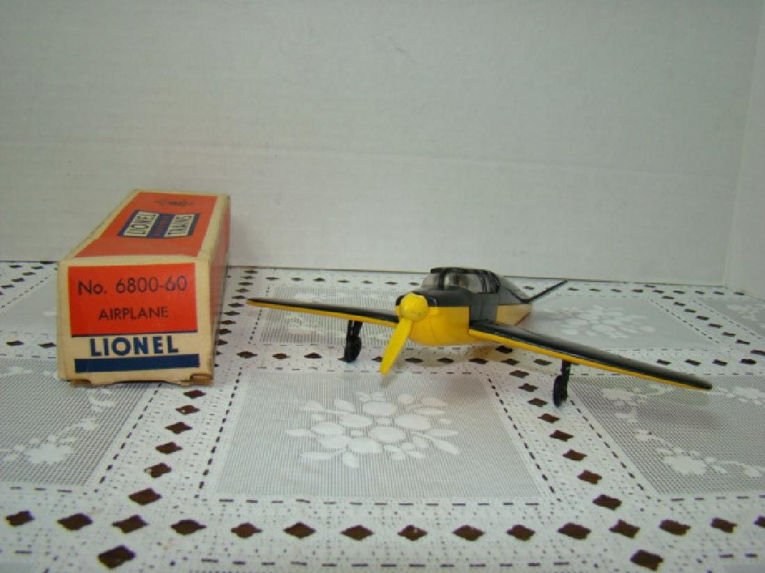 LIONEL TRAINS-BLACK ON YELLOW AIRPLANE IN ORIGINAL