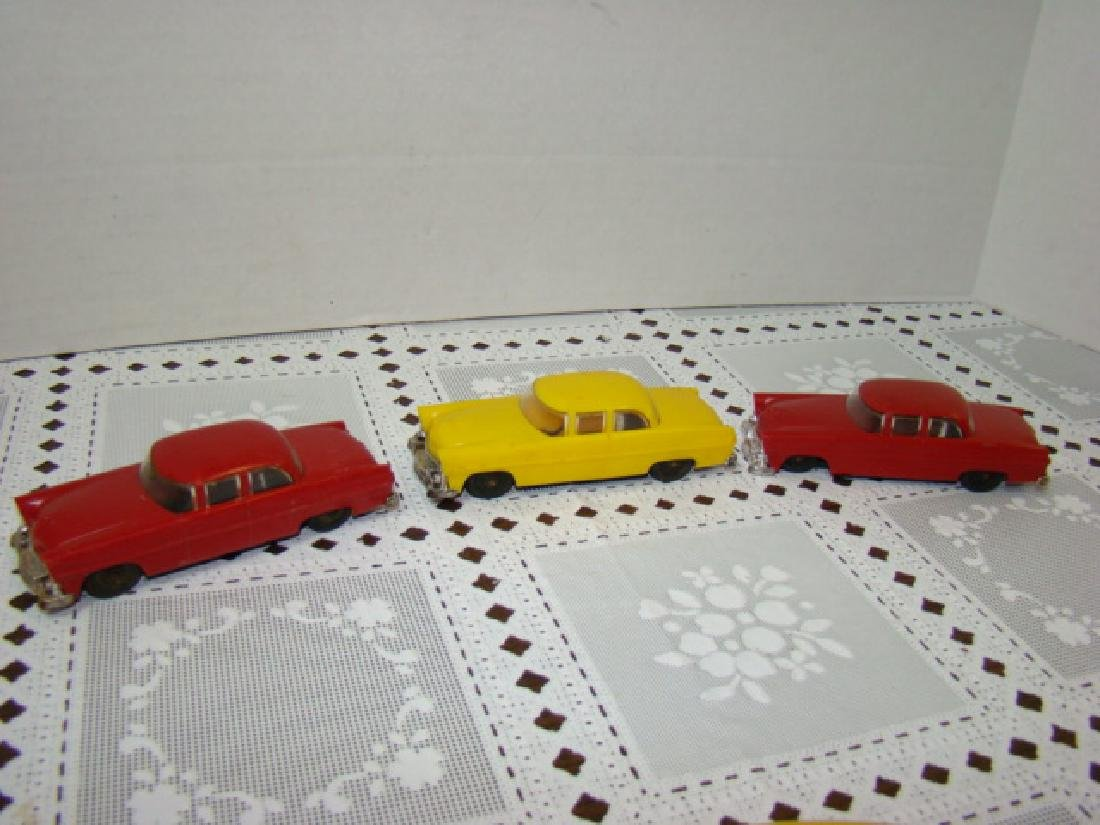 3 LIONEL TOWN CARS - 2 RED & 1 YELLOW