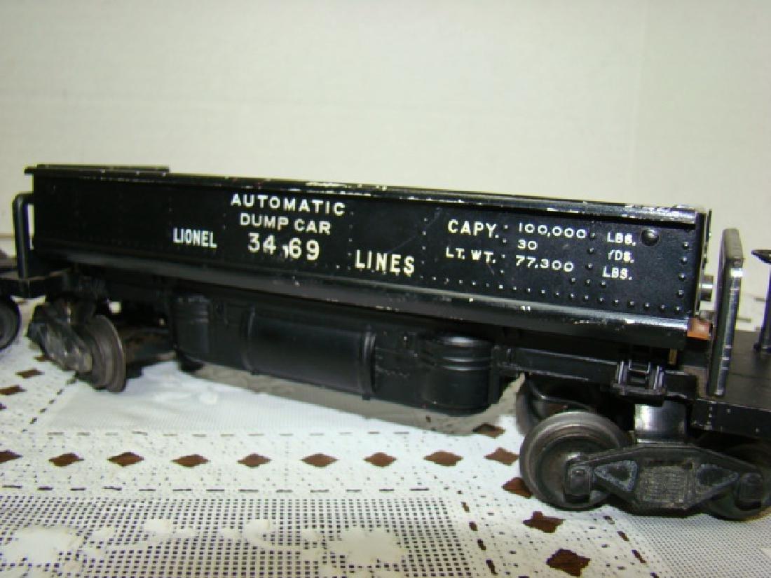 2 LIONEL LINES AUTOMATIC METAL DUMP CARS - 2