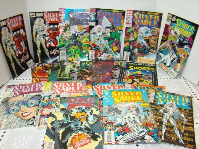 COMIC BOOKS-CATWOMAN-SUPERGIRL-SPIDERWOMAN & MORE