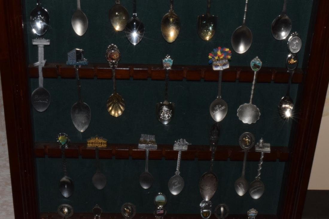 29 VARIOUS COLLECTOR SPOONS IN RACK