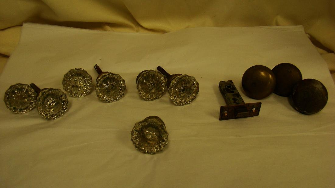 ANTIQUE GLASS AND BRASS DOOR KNOBS