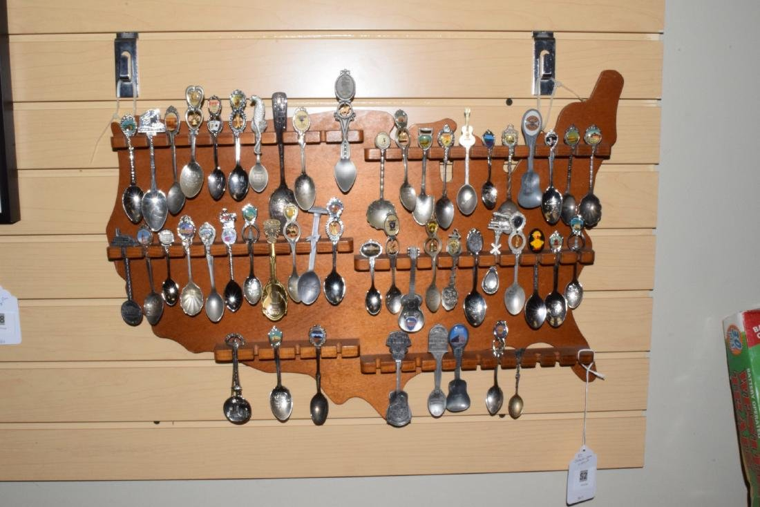 51 VARIOUS COLLECTOR SPOONS IN RACK