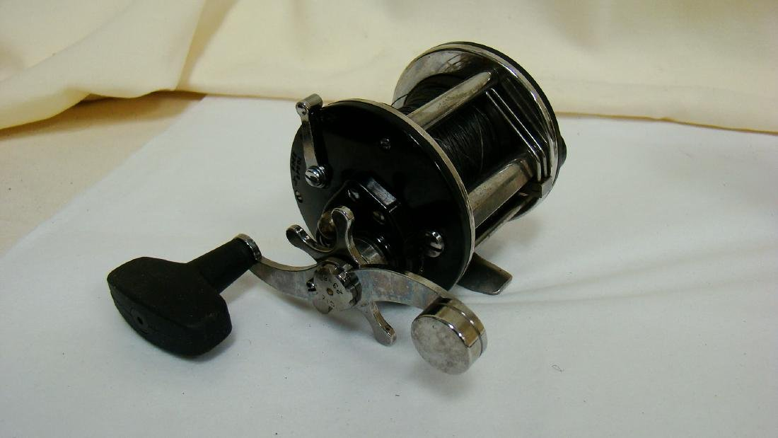 PAIR OF SPINNING FISHING REELS - 2