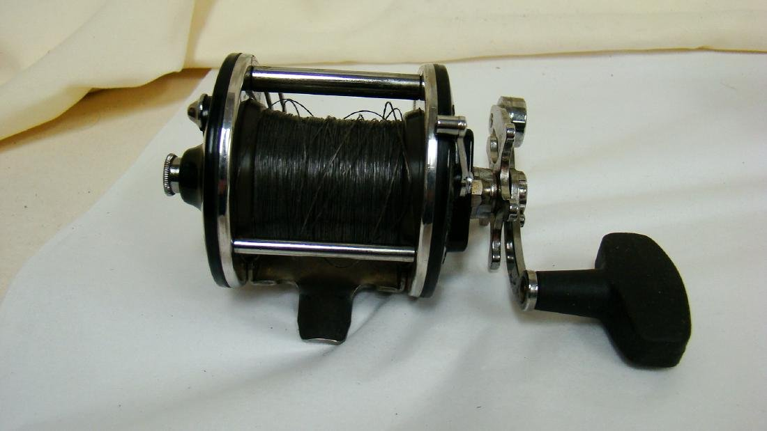 PAIR OF SPINNING FISHING REELS - 3