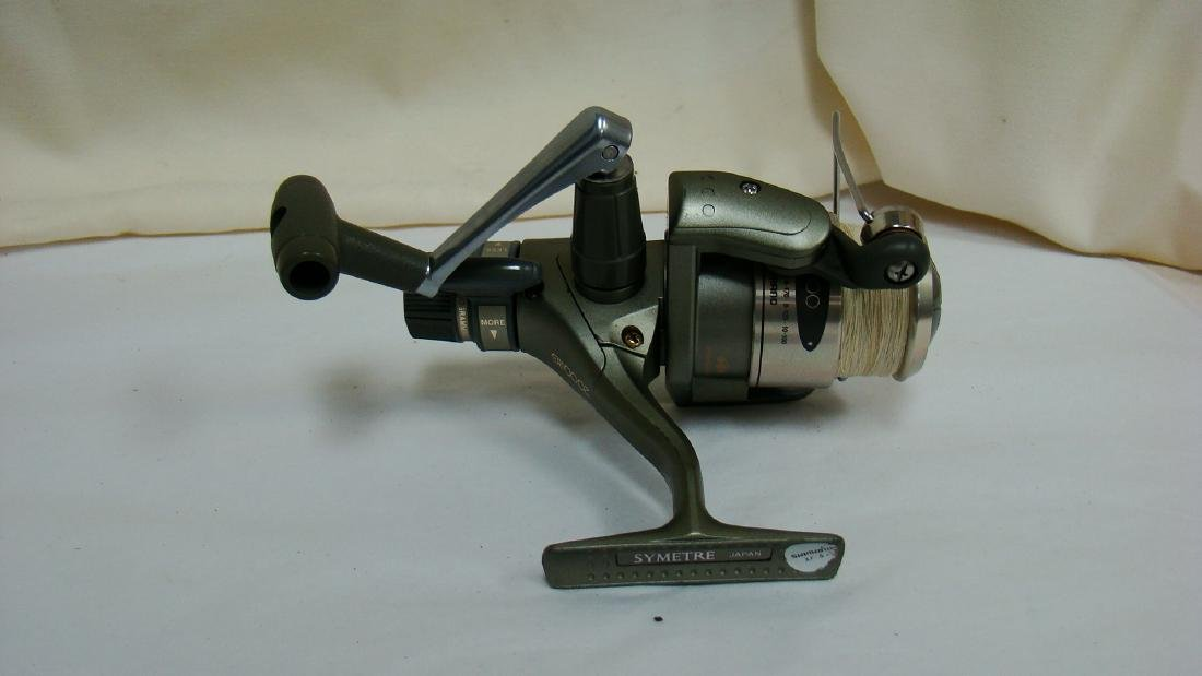 PAIR OF SPINNING FISHING REELS - 6