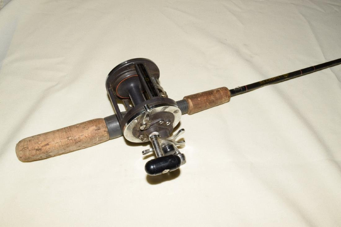 2 FISHING POLES WITH REELS - 4