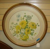 VINTAGE ROUND GLASS AND FRAMED PRINT OF YELLOW FLOWERS