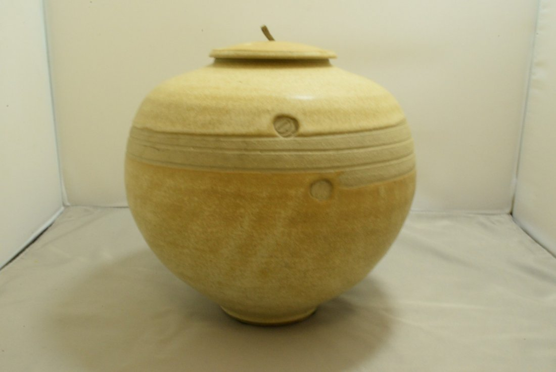 SIGNED POTTERY JAR WITH LID
