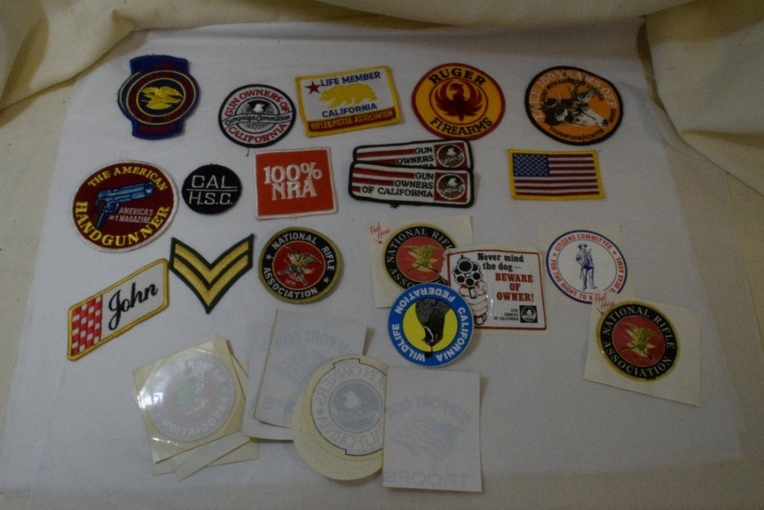TRAY OF VARIOUS MILITARY AND NRA PATCHES AND STICK