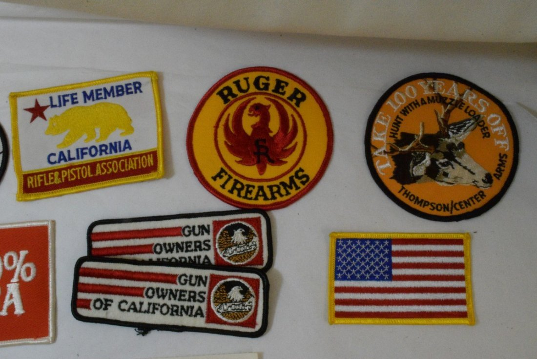 TRAY OF VARIOUS MILITARY AND NRA PATCHES AND STICK - 3