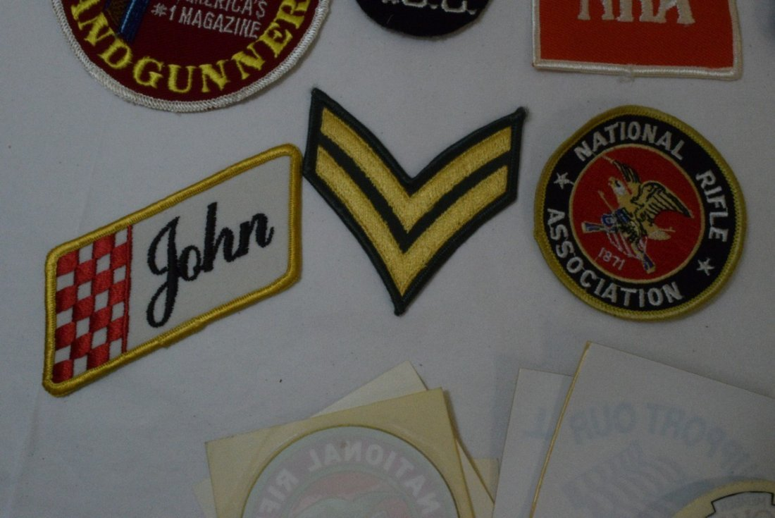 TRAY OF VARIOUS MILITARY AND NRA PATCHES AND STICK - 6