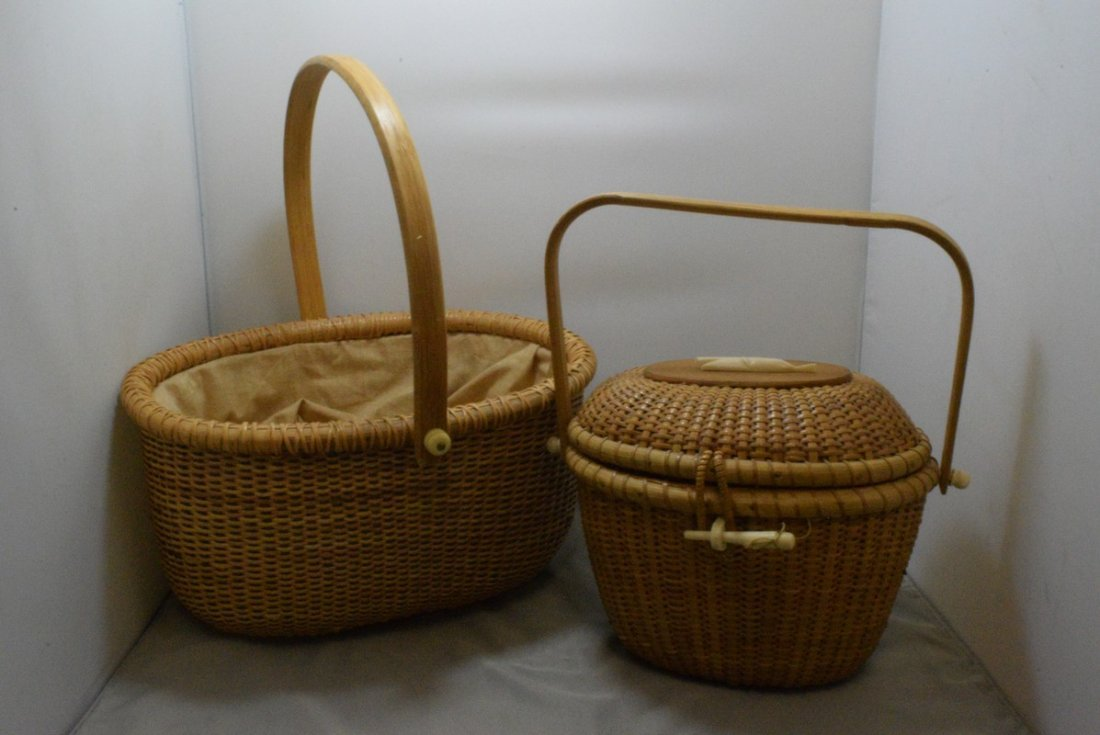 2 HAND WOVEN BASKETS WITH CARVED BONE LIKE TRIM