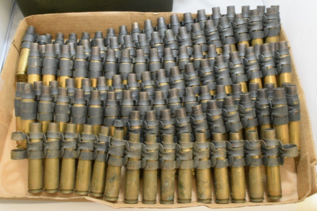 BOX WITH 4 STRIPS OF EMPTY .50 CAL CASINGS AND A M - 2