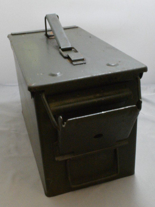 BOX WITH 4 STRIPS OF EMPTY .50 CAL CASINGS AND A M - 3