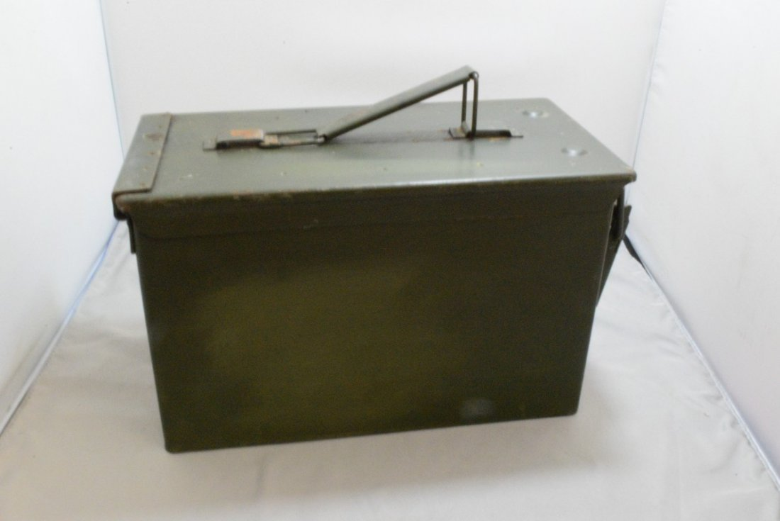 BOX WITH 4 STRIPS OF EMPTY .50 CAL CASINGS AND A M - 4