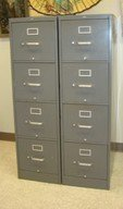 TWO GREY METAL FOUR DRAWER METAL FILING CABINETS