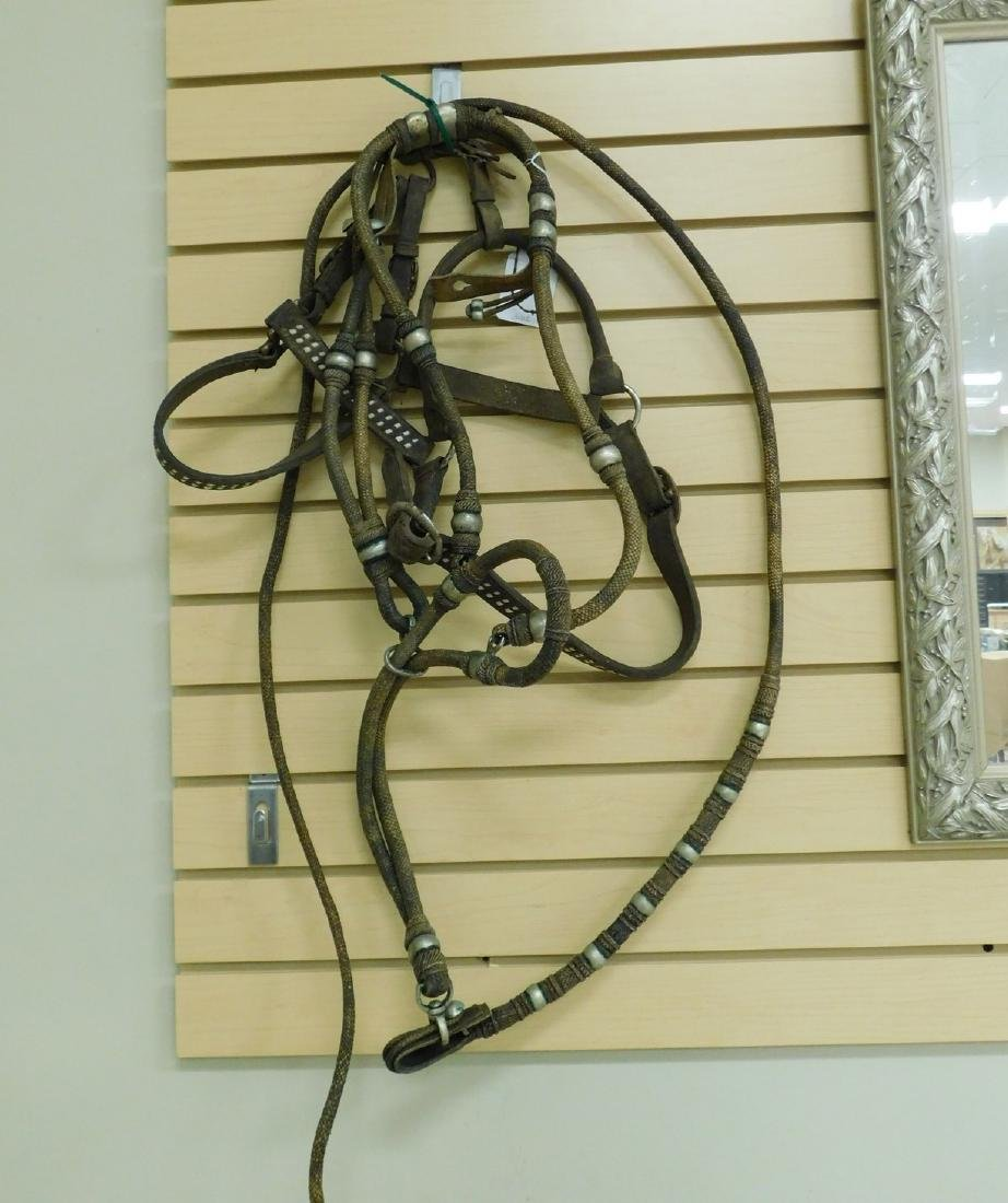 USED HACKAMORE BRIDLE AND A LEATHER HALTER