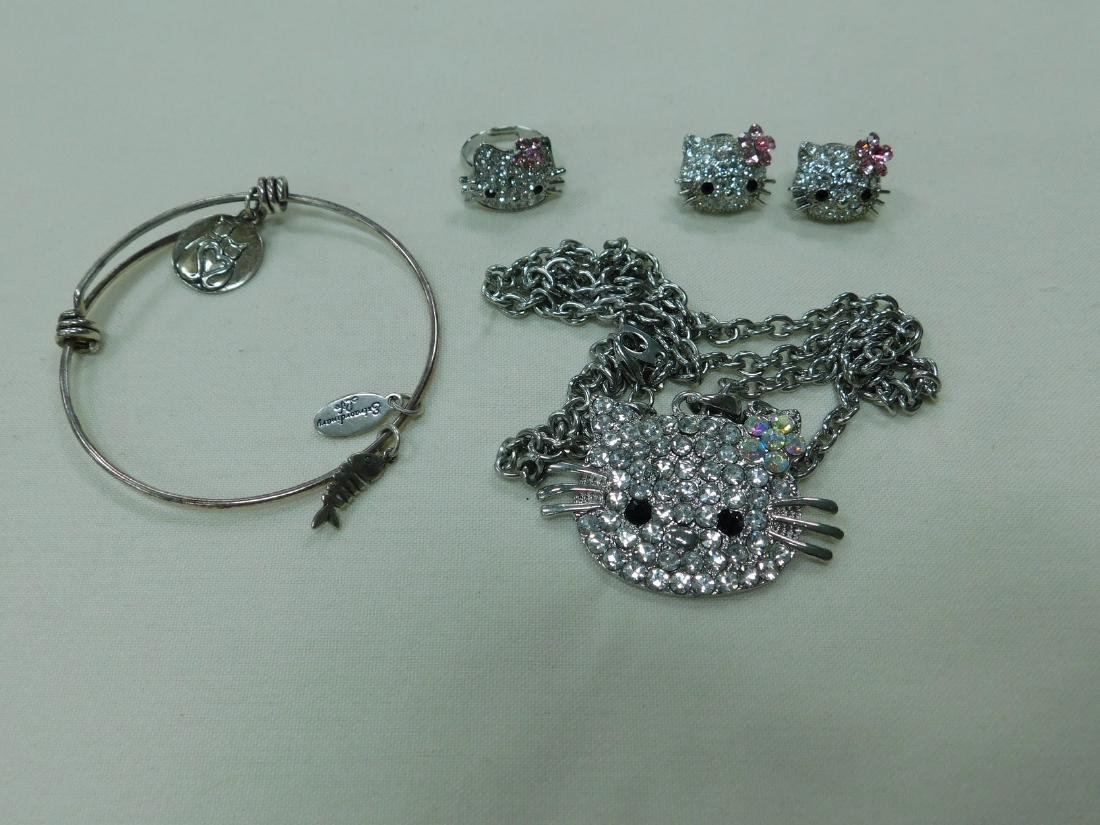 VARIOUS HELLO KITTY RHINESTONE JEWELRY AND A BRACE