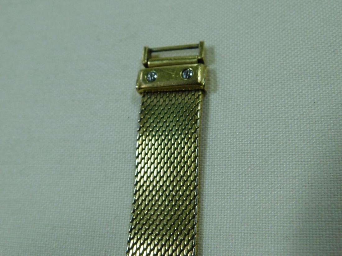 BUCHERER GOLD TONE LADIES WATCH - 6