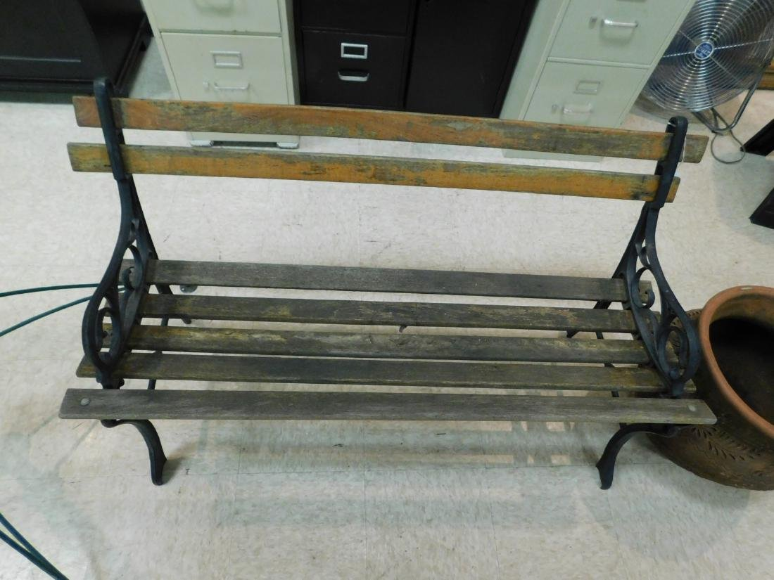 WOOD SLAT YARD BENCH WITH CAST IRON ENDS AND 1 POT - 2