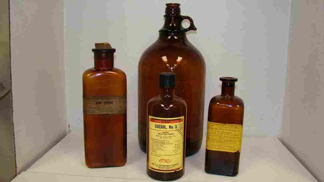 4 VTG AMBER GLASS MEDICINE BOTTLES