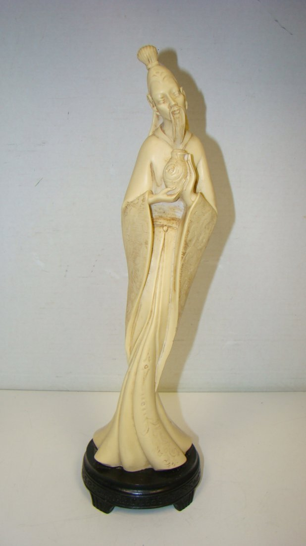 13.25'' CARVED RESIN ASIAN FIGURE ON BASE