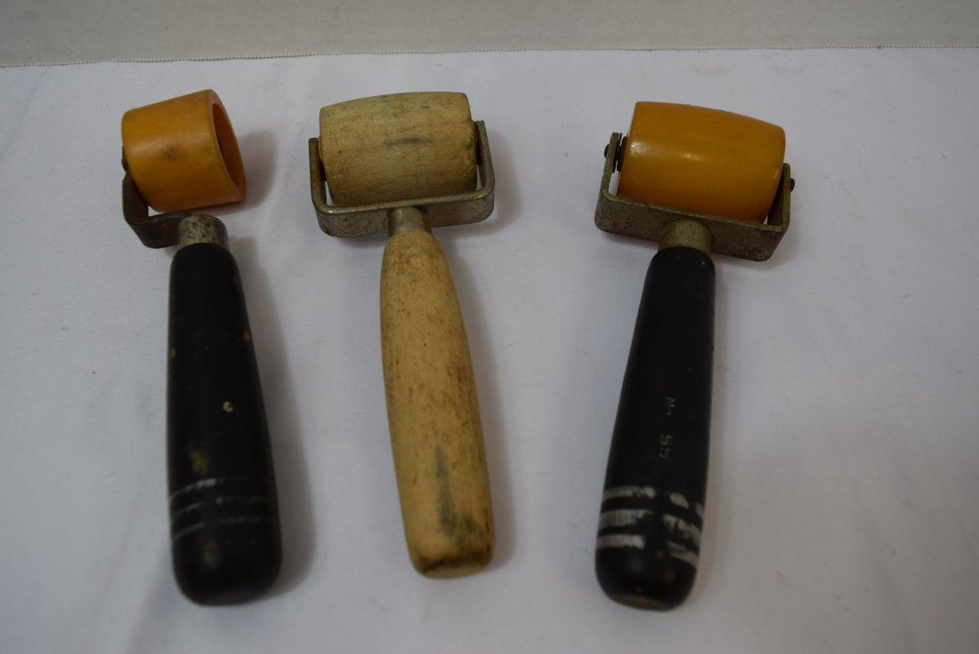 2 BAKELITE AND ONE WOOD WALLPAPER ROLLERS