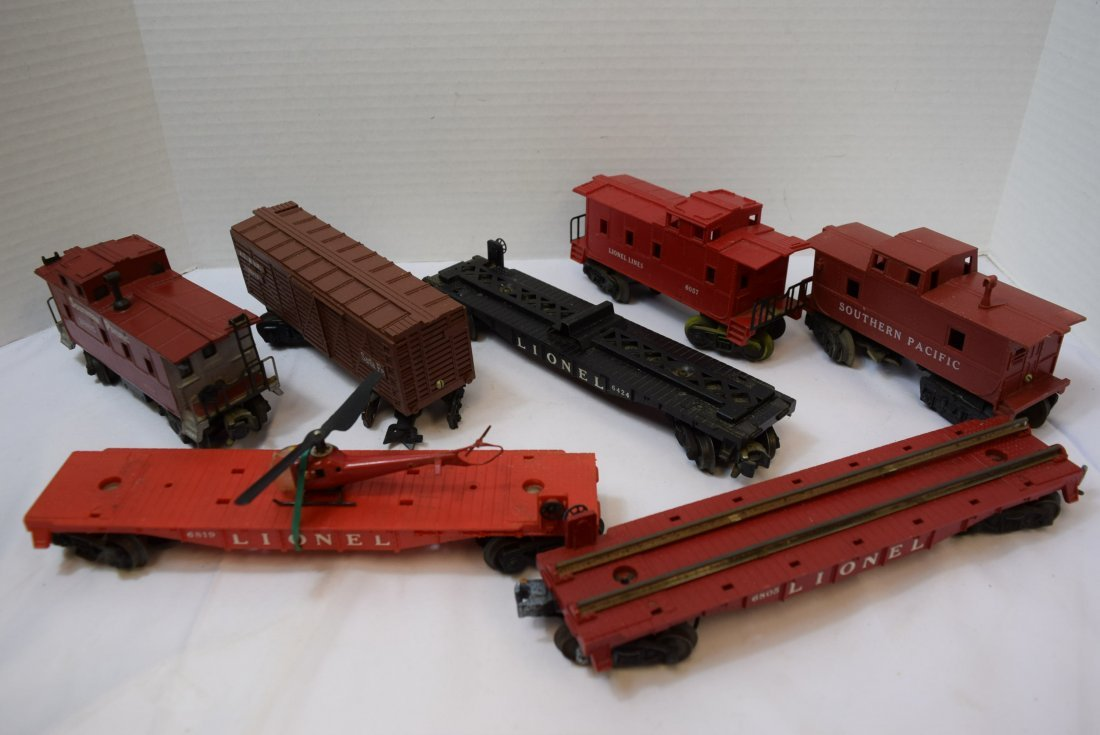 7 PIECE BOX LOT OF LIONEL AND OTHER ROLLING TRAIN