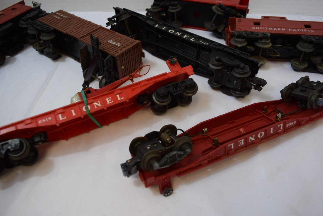 7 PIECE BOX LOT OF LIONEL AND OTHER ROLLING TRAIN - 7