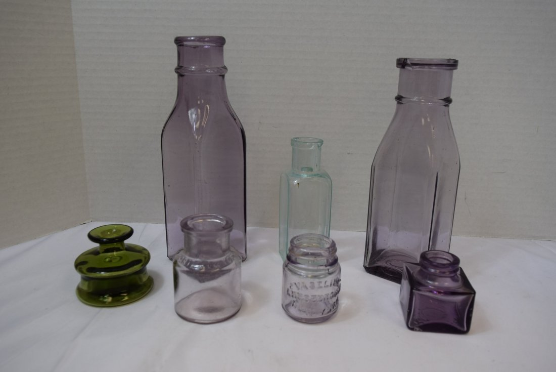 7 VARIOUS ANTIQUE BOTTLES IN VARIOUS COLORS