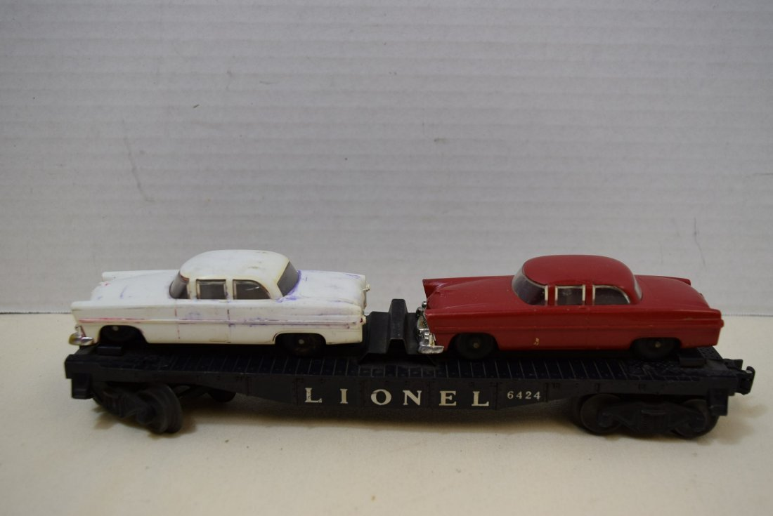 LIONEL FLAT CAR HAULER WITH 2 CARS