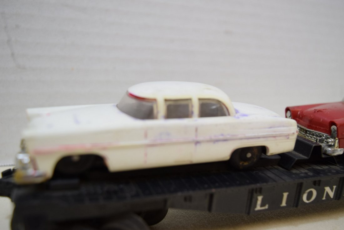 LIONEL FLAT CAR HAULER WITH 2 CARS - 2