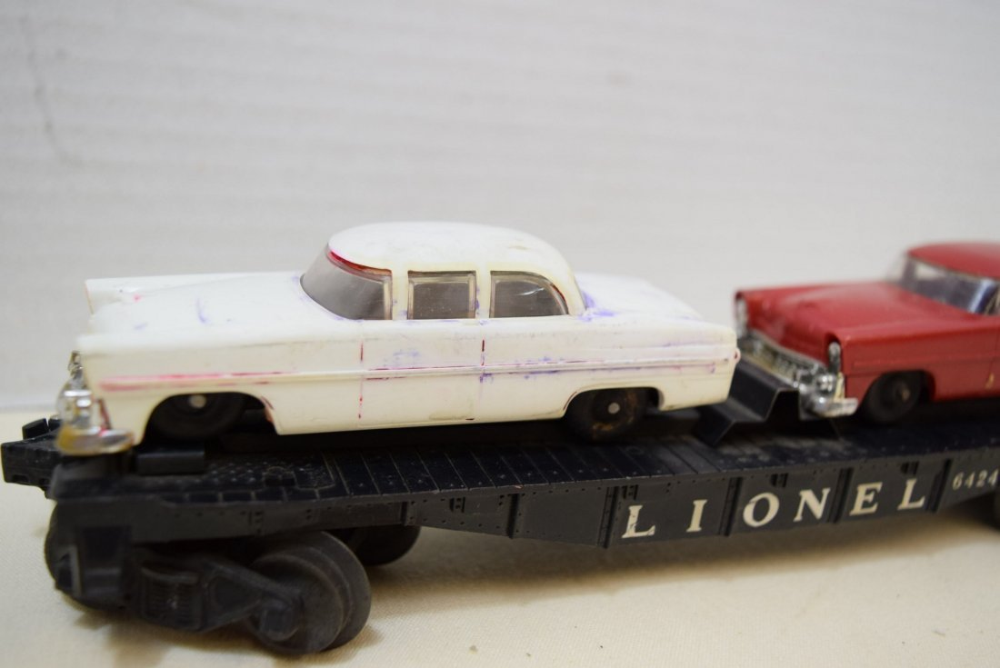 LIONEL FLAT CAR HAULER WITH 2 CARS - 3
