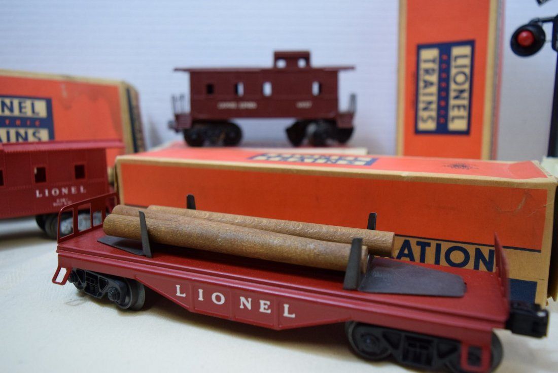 2 LIONEL CABOOSES; FLAT CAR AND RINGING HIGHWAY SI - 2