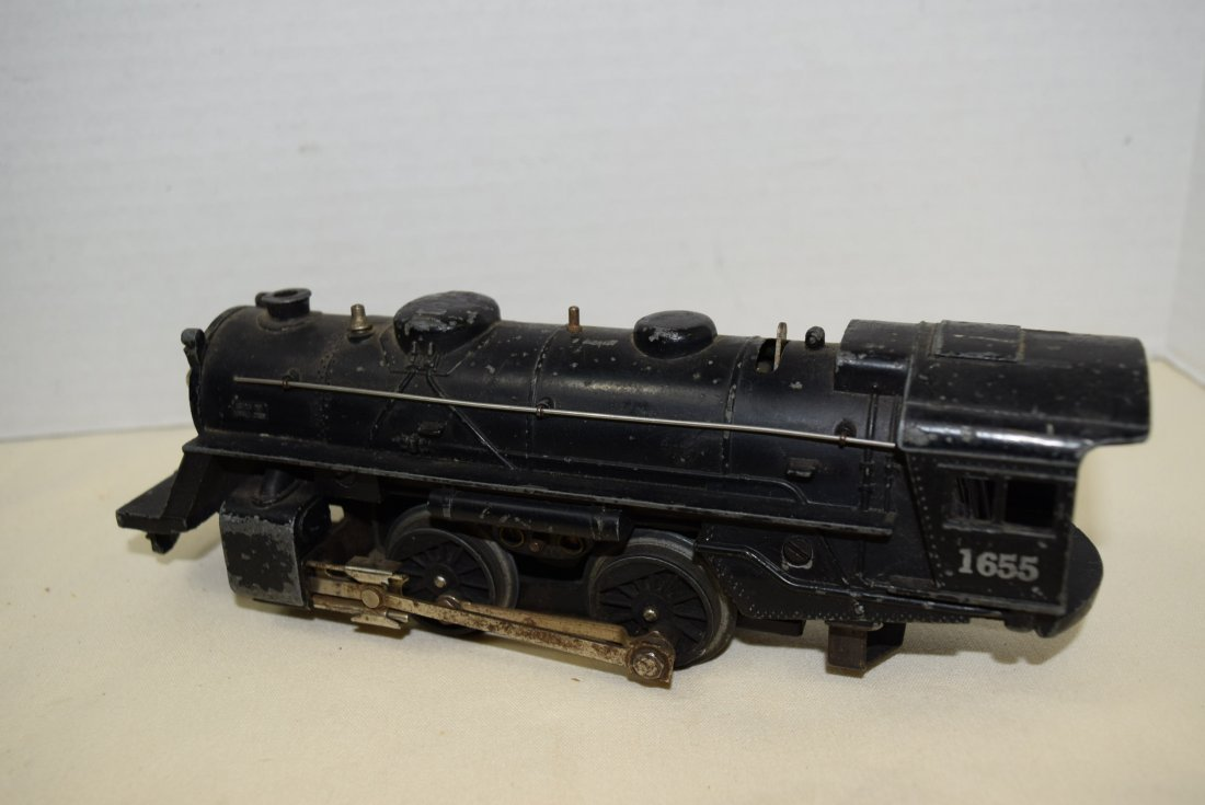 LIONEL LOCOMOTIVE AND 3 ROLLIING CARS - 5