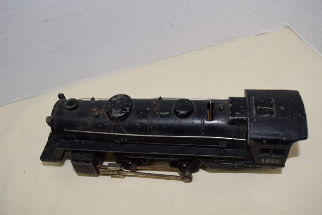 LIONEL LOCOMOTIVE AND 3 ROLLIING CARS - 6