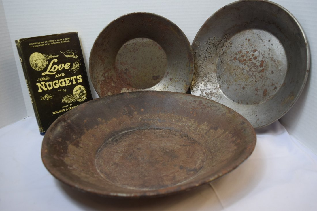 3 VINTAGE PRIMITIVE GOLD MINING PANS AND A BOOK