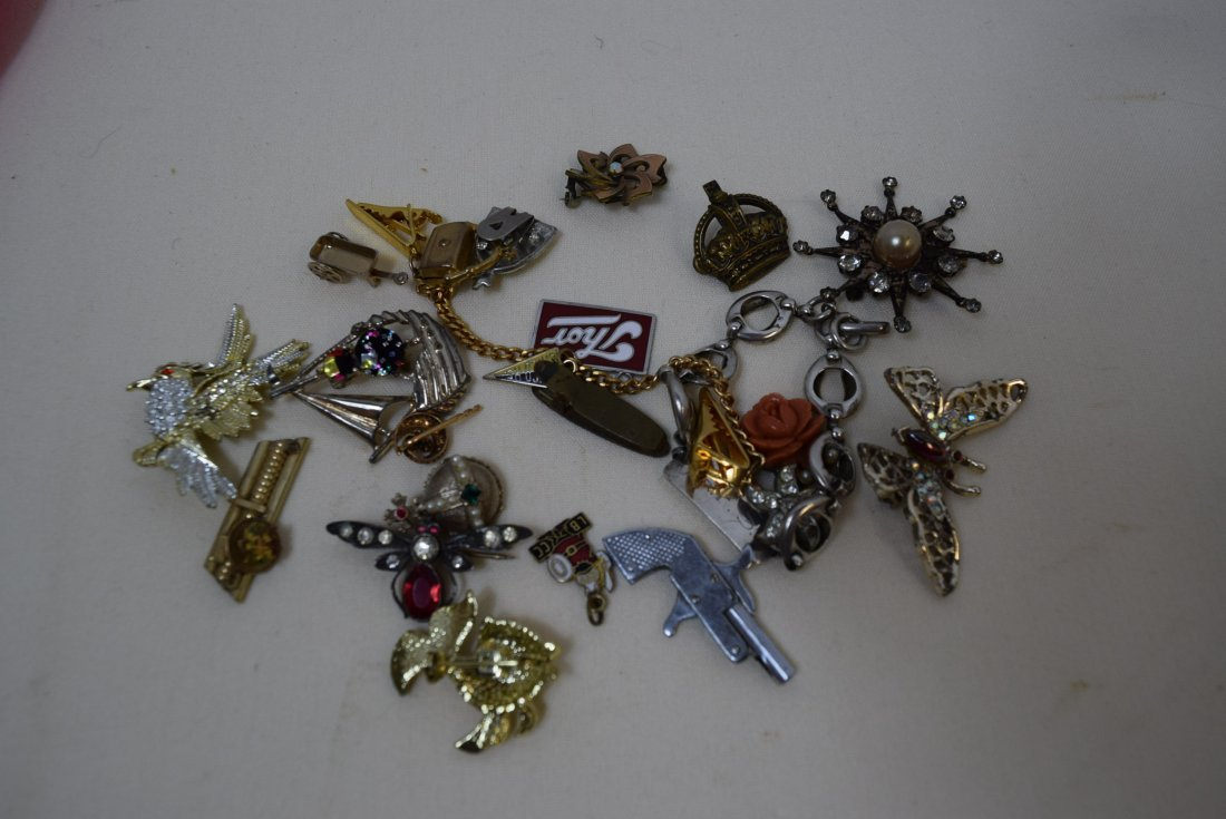 LOT OF PINS; PENDANTS; CLIPS AND MORE