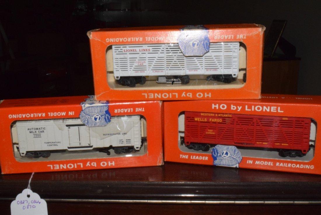 LIONEL HO SCALE TRAIN- SHERIFF & OUTLAW CAR-MILK C