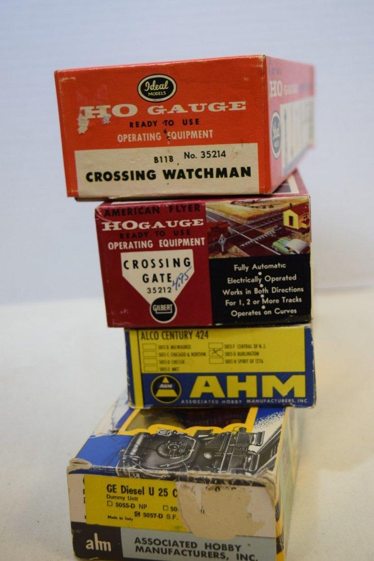 2 AHM LOCOMOTIVES & 2  MODEL ACCESSORY KITS FOR HO - 7