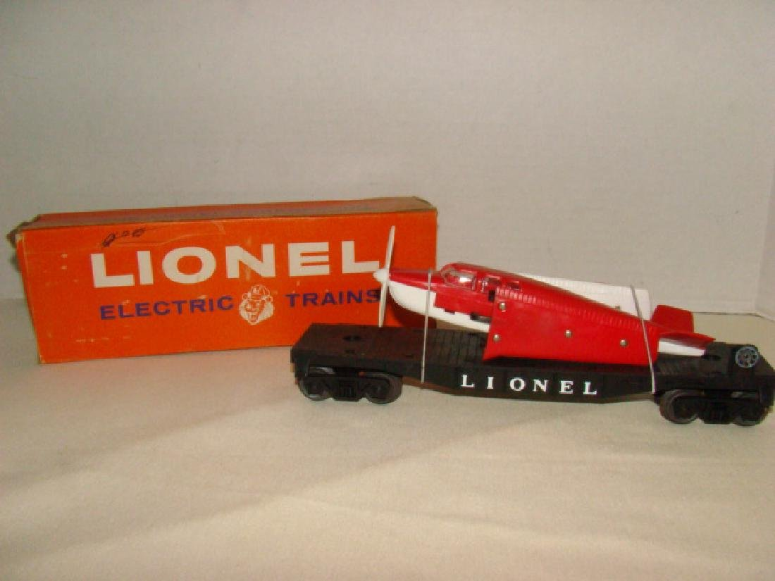 LIONEL AIRPLANE TRANSPORT CAR WITH RED AIRPLANE-NIB