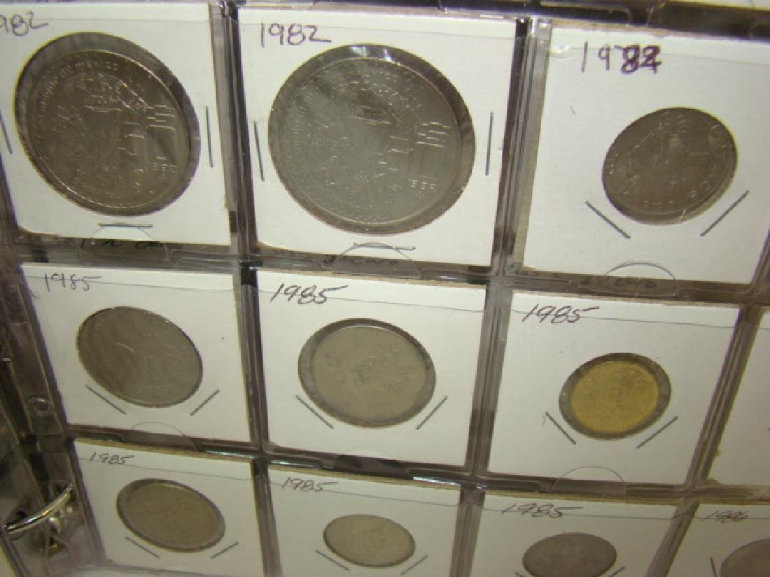FOREIGN COINS IN BINDER - 7