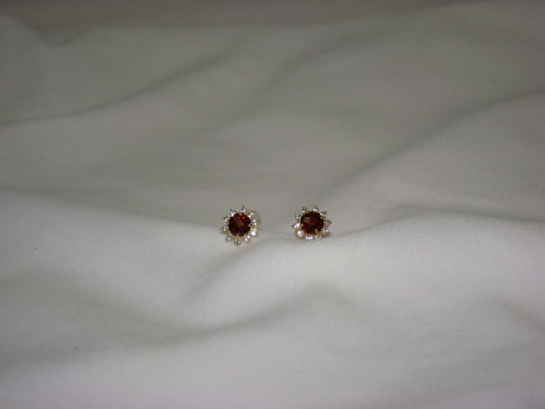 10 K GOLD EARRINGS WITH RUBY COLOR STONES
