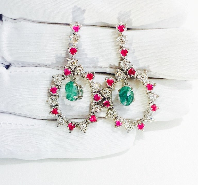 14K white gold; Super Burma ruby and emerald earrings